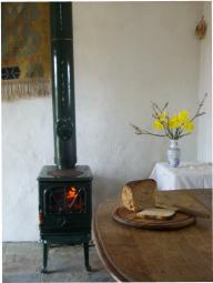 Fire burning in the woodstove, a loaf of bread on the table